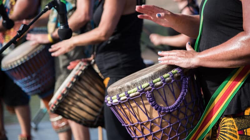 Drummers beating to a rhythm together